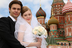 Bride, fiance and cathedral Stock Images
