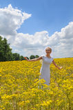 Bride in Field of Yellow Flowers Royalty Free Stock Photography