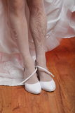 Bride fitting shoes Stock Photos