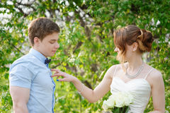 Bride flirting with groom on a walk in spring garden Royalty Free Stock Photography