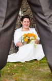 Bride flirting with new husband Royalty Free Stock Images
