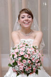 Bride with floral bouquet Stock Image