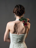 Bride with a flower. Beautiful woman with red roses Stock Photos