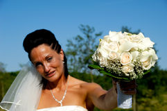 Bride with flower bouquet Stock Photos