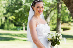 Bride with flower bouquet in garden Royalty Free Stock Images