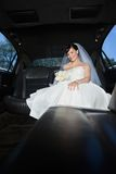 Bride With Flower Bouquet in Limo Royalty Free Stock Image