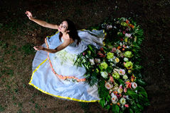 Bride in a flower dress pulled up Stock Image