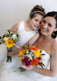 Bride and flower girl. With faces together royalty free stock photo