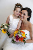 Bride and flower girl. With faces together royalty free stock images