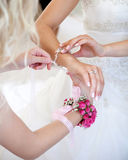 Bride and flower girl. Flower girl putting jewelry on bride Royalty Free Stock Images