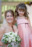 Bride With Flower Girl. Beautiful Bride Posing With Her Flower Girl royalty free stock photography