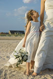 Bride and Flower Girl on Beach Royalty Free Stock Photo