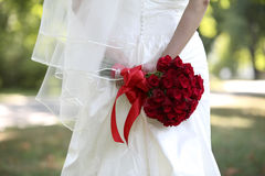 Bride flowers. The bride flowers, roses, hold by the bride Stock Image