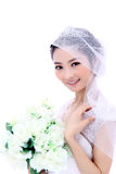 Bride with flowers. Bride wearing silk dress holding beautiful bouquet of white roses Royalty Free Stock Photos