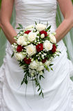 Bride with flowers. Bride holding a bouquet of flowers on her wedding day Stock Photo