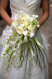 Bride with flowers. Bride holding a bouquet of flowers on her wedding day Stock Images