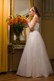 Bride and flowers Royalty Free Stock Images