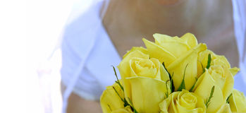 Bride with flowers. Bride holding her bouquet royalty free stock image