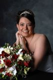 Bride and Flowers. A elegant smiling bride posing for her wedding day celebration Stock Images