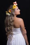 Bride With Flowers Garland. On her head, with long, curly hair Royalty Free Stock Images