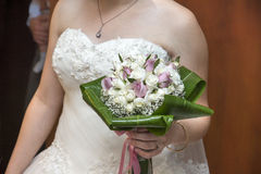 Bride with Flowers. Bride holding beautiful bouquet flowers Royalty Free Stock Image