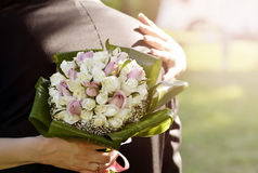Bride with Flowers. Bride holding beautiful bouquet flowers Stock Image