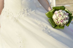 Bride with Flowers. Bride holding beautiful bouquet flowers Royalty Free Stock Photo