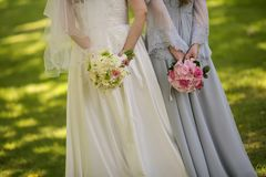 Bride with flowers and maids. Of honor Royalty Free Stock Image