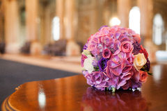 Bride flowers. The bride flowers, roses, set on a wooden table Stock Photo