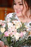Bride with flowers on the wedding day.  Royalty Free Stock Image