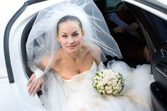Bride with flowers in the white car Stock Photography