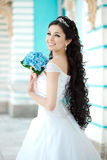 Bride with flowers Stock Image