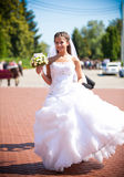 Bride in fluffy dress walking at park alone Stock Image