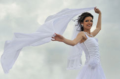 The bride with a fluttering veil Royalty Free Stock Image