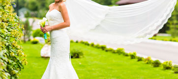 Bride with flying long veil Royalty Free Stock Photography