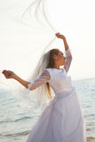 Bride with flying veil Royalty Free Stock Photo