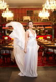 Bride in flying wedding dress in the restaurant Royalty Free Stock Image