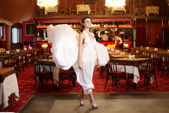 Bride in flying wedding dress in the restaurant Royalty Free Stock Photos