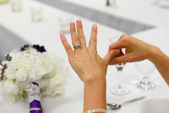 Bride Focus on Hand. Every bride loves to admire her sparkling new wedding ring right after her ceremony.  This simple shot focusses on the ring and has just Royalty Free Stock Images