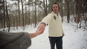 Bride and Following Her Groom in Winter Forest stock video