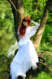 Bride in forest Stock Photo