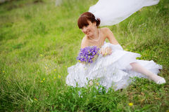 Bride in fresh grass Stock Image