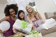 Bride And Friends Holding Gifts At Hen Party Royalty Free Stock Images