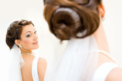 Bride in front of the mirror Royalty Free Stock Photography
