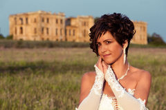 Bride in front of the palace ruins, portrait Royalty Free Stock Images
