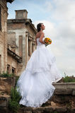 Bride in front of ruins, in profile Royalty Free Stock Photo
