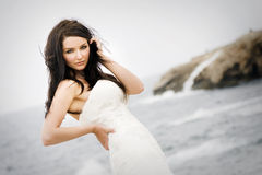 Bride in front of the sea Stock Image