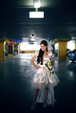 Bride in the garage Stock Image