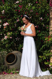 Bride in a garden. Bride looking at her bouquet in a garden Stock Photo