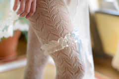 Bride garter. On leg with stockings Stock Photography